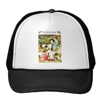 Christmas greeting with a mother playing with kids trucker hat