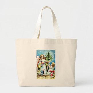 Christmas greeting with an angel carrying christma bag