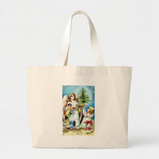 Christmas greeting with an angel carrying christma large tote bag