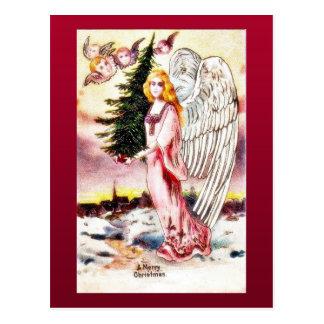 Christmas greeting with an angel carrying christma postcard