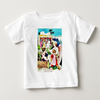 Christmas greeting with an angel showing the crib tee shirts