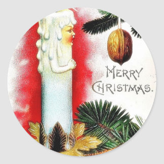 Christmas greeting with candle made as human classic round sticker