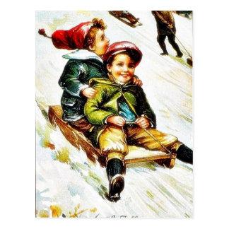 Christmas greeting with kids snow slading postcards