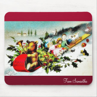 Christmas greeting with riding a snow sled a snow mouse pad