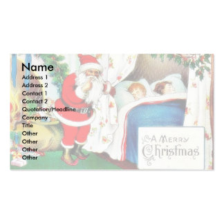 Christmas greeting with santa claus looking at two Double-Sided standard business cards (Pack of 100)