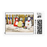 Christmas greeting with snow man presents gifts to postage stamp