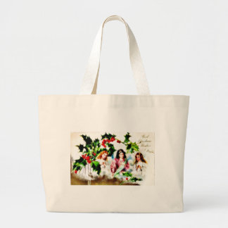 Christmas greeting with three angels praying tote bags