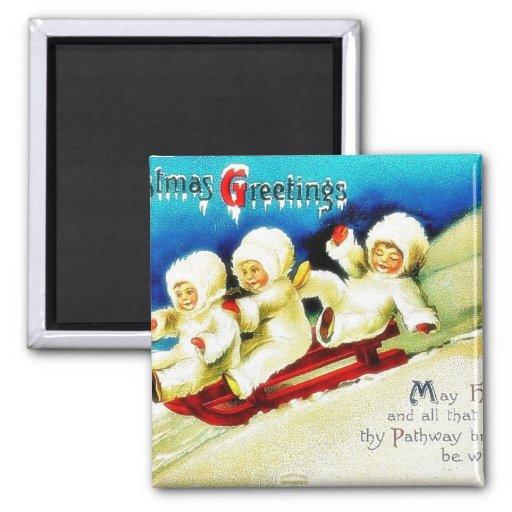 Christmas greeting with three kids snow slading fridge magnets