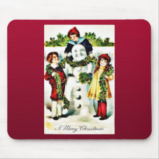 Christmas greeting with three kids wearing a garla mouse pad