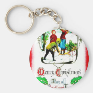 Christmas greeting with three persons picking up s key chains