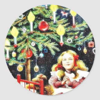 Christmas greeting with two girls sitting on a din classic round sticker