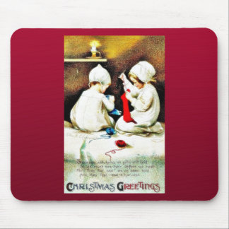 Christmas greeting with two girls stiching shocks mouse pad