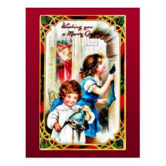 Christmas greeting with two kids holding gifts, sa postcard