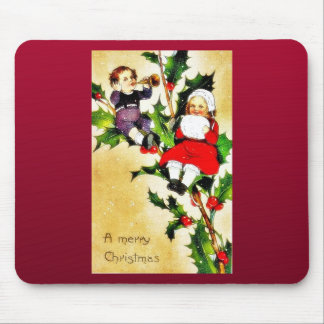 Christmas greeting with two kids sitting on a bran mouse pad