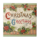"""Christmas Greetings Holly Tile<br><div class=""""desc"""">Christmas greetings. This vintage Christmas print depicts the phrase Christmas greetings surrounded by holly.</div>"""