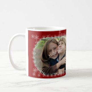 Christmas greetings on red background with snow coffee mug