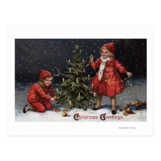 Christmas GreetingsKids Decorating a Tree Postcard