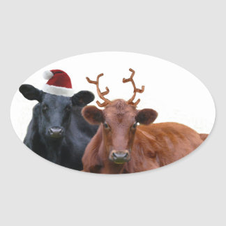 Christmas Holiday Cows in Santa Hat and Antlers Oval Sticker