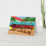 """Christmas In July Holiday Folded Greeting Card<br><div class=""""desc"""">Christmas In July Greeting Card. Fun and quirky card to send in July just because you can. Featuring a 3d rendered scene of Christmas on holiday on the beach (he's in the shade of a hammock) and has been building sandcastles  - he's having fun in the sun</div>"""