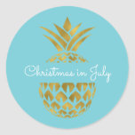 "Christmas in July Pineapple Tropical Holiday Classic Round Sticker<br><div class=""desc"">Australian Christmas in July Faux Foil Gold and Aqua Blue Pineapple Christmas Blue Postage Sticker. This Hawaiian Christmas sticker is perfect for sealing a tropical Family Christmas Card.</div>"
