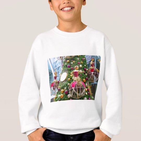 Christmas manniquins on a tree sweatshirt