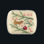 """Christmas Mouse Decorates The Tree Candy Tin<br><div class=""""desc"""">This helpful holiday mouse decorating the Christmas tree with a bright red ball is hand-painted watercolor,  with hand-lettered """"Fa-la-la-la-la"""" to get you singing with Christmas spirit.</div>"""