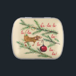 "Christmas Mouse Decorates The Tree Candy Tin<br><div class=""desc"">This helpful holiday mouse decorating the Christmas tree with a bright red ball is hand-painted watercolor,  with hand-lettered ""Fa-la-la-la-la"" to get you singing with Christmas spirit.</div>"