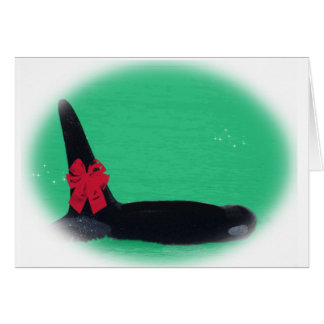 Christmas Orca Whale with Red Bow on Green Backgro Card