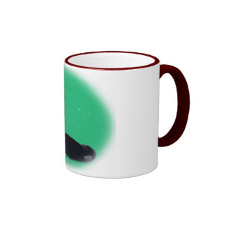 Christmas Orca Whale with Red Bow on Green Backgro Coffee Mugs