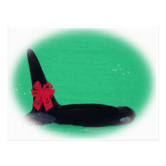 Christmas Orca Whale with Red Bow on Green Backgro Postcard