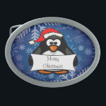 """Christmas Penguin Oval Belt Buckle<br><div class=""""desc"""">This adorable penguin is ready for the holidays,  text can be personalized.</div>"""