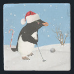 """Christmas, Penguin Playing Golf Stone Coaster<br><div class=""""desc"""">A penguin wearing a red and white Santa Claus hat is getting read to strike the golf ball on the snowy playing field. A red and white candy cane sticks up from the snow behind the penguin and a leafless bush is in the right part of the image. Snowflakes are...</div>"""