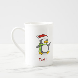 Christmas penguin walking on snow tea cup