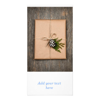 Christmas present in brown paper tied with string custom photo card