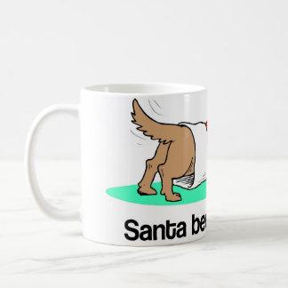 Christmas puppy (dog) checking Christmas stocking Mugs