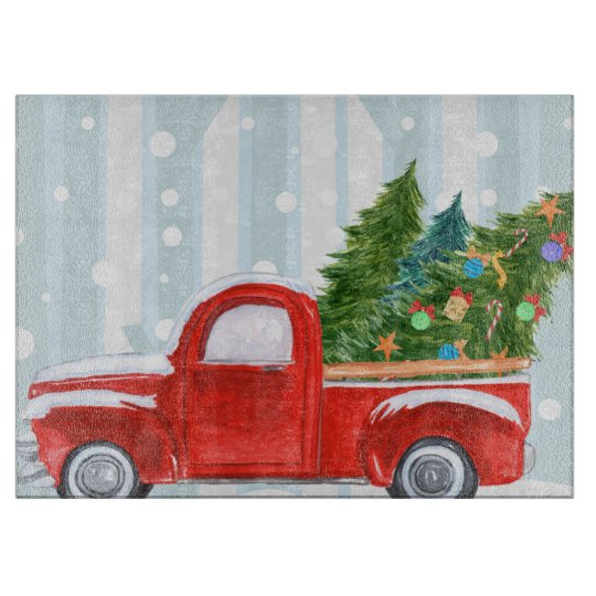Old Red Truck With Christmas Tree In Back.Christmas Red Pickup Truck On A Snowy Road Cutting Board