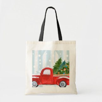 Christmas Red PickUp Truck on a Snowy Road Tote Bag