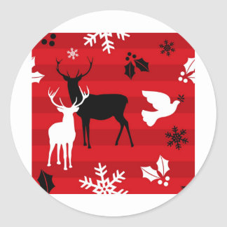 Christmas reindeers over red classic round sticker