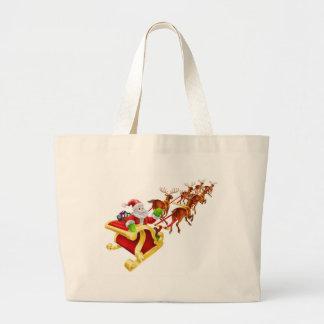Christmas Santa Claus flying in sleigh Tote Bags