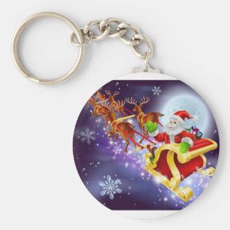 Christmas Santa flying in his sled or sleigh Key Chain