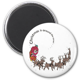 Christmas: Santa, his sleigh and reindeer in snow 2 Inch Round Magnet