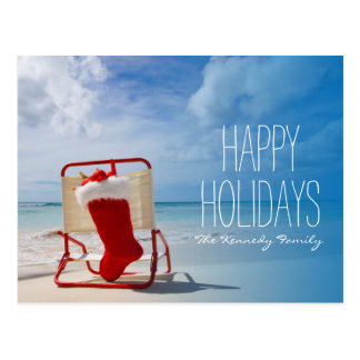 Christmas stocking on a beach chair postcard