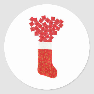 Christmas stocking with giftboxes coming out of it classic round sticker