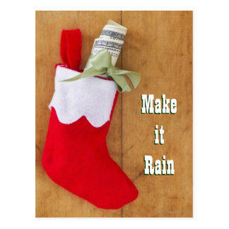 Christmas stocking with roll of money postcard