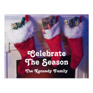 Christmas stockings hanging from fireplace postcard