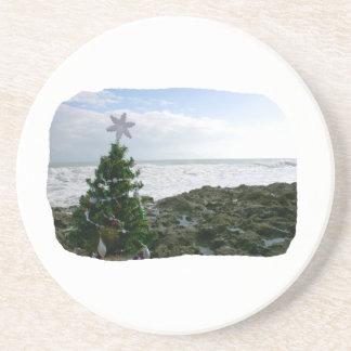 Christmas Tree Against Beach Rocks Coasters
