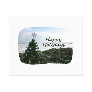 Christmas Tree Against Beach Rocks Happy Holidays Stretched Canvas Print