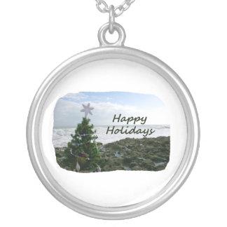Christmas Tree Against Beach Rocks Happy Holidays Round Pendant Necklace