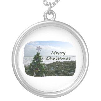Christmas Tree Against Beach Rocks Merry Christmas Round Pendant Necklace