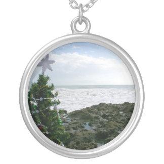 Christmas Tree Against Beach Rocks Round Pendant Necklace